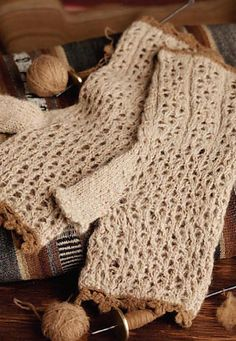 Ravelry: Wild and Warm Lace Fingerless Gloves pattern by Kaye D. Collins