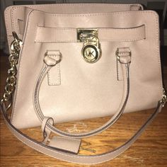 Michael Kors Hamilton Medium sand beige Michael Kors Hamilton. I've got a new purse and have to let this one go! This was my baby but I am willing to sell or possibly trade. Clean and Undamaged (sold listing below was a trade that was canceled, purse is still available) Michael Kors Bags