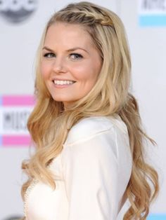 Growing Out Your Bangs Option:  Baby Braid  A front braid, like Jennifer Morrison's, is ideal for securing short hairs. Smooth flyaways with hairspray when you're done styling.