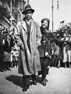 Mr. and Mrs. Joe Louis take a stroll though Harlem, September 25, 1935.