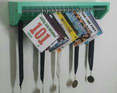 Trendy Running display for race bibs and medals-Black. race bibs holder, medal holder, medals and bibs display, running bibs display, custom Running Bib Display, Race Bib Display, Trophy Display, Award Display, Display Ideas, Running Bibs, Running Medals, Running Gear, Mtb