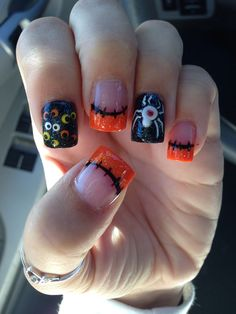 Halloween acrylic nails with spider and eyes