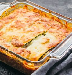 Zucchini lasagna in baking dish immediately after roasting with a golden brown cheesy surface
