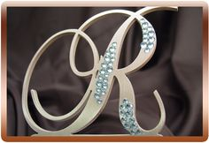 Google Image Result for http://www.creationmetals.com/Images/monogram-wedding-toppers.jpg