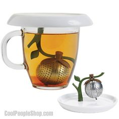 Tea Infuser and Saucer.