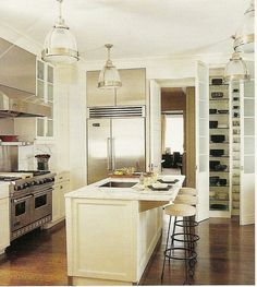 great combo of white cabinets with stainless steel appliances