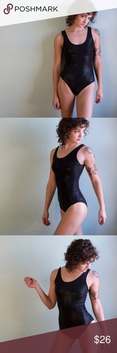 Black Bodysuit with Reflective Stripes Lightweight bodysuit/leotard with shiny stripe pattern that picks up light. Super stretchy and feels amazing! So comfortable and soft. This is a closet staple for 2018! No lining. Pre-loved: This is a pre-loved item that lives up to our high standards of quality materials and condition. Buy used and save the planet! Vintage Swim One Pieces