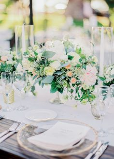 Elegant garden wedding centerpiece. Take a look at this rustic cream & blush Arizona wedding captured by Rachel Solomon Photography. http://www.colincowieweddings.com/flowers-and-decor/rustic-cream-blush-arizona-wedding