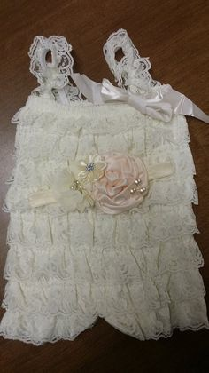 Check out this item in my Etsy shop https://www.etsy.com/listing/202312918/vintage-ivory-lace-petti-romper-w