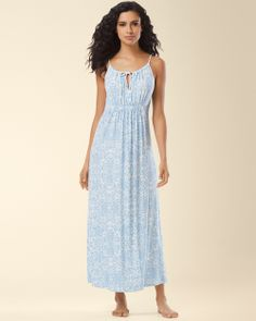 Midnight by Carole Hochman Night Gown in Island Life Blue Print. Let your relaxing tropical tendencies follow you to the sheets. Soft, fluid nightgown with a luxuriously long silhouette and touches of satin.