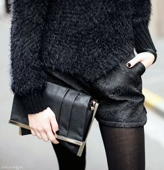 The triple trend of Brocade shorts, mohair sweater and a pleated clutch.