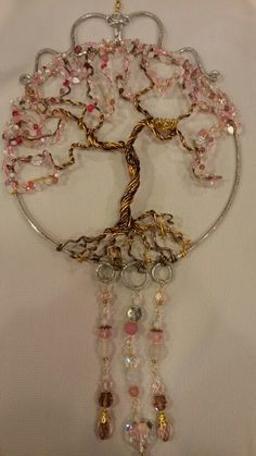 Wire wrapped beaded Tree of life sun catcher with bird's nest cherry blossom.