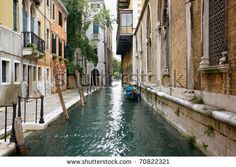 stock photo : View of ancient buildings and narrow canal with gondola.Venice