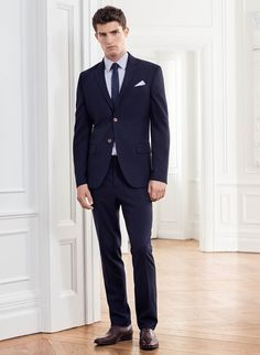 A slim-fitting suit in varying shades of blue will take you from office to bar without sacrificing style. Choose a short-sleeved shirt for a casual look once your blazer comes off.
