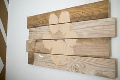 Blue and gold, dog themed nursery with gold arrow wall | BabyRabies.com - DIY Wood Art from reclaimed wood, project family dog paw print, trace, and paint
