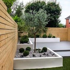 Small, low maintenance garden: minimalistic Garden by Yorkshire Gardens Cheap Landscaping Ideas, Backyard Landscaping, Backyard Ideas, Diy Wall Planter, Vertical Wall Planters, Planter Pots, Planter Ideas, Design Patio, Small Garden Design