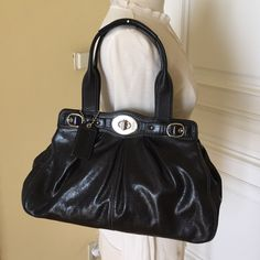 Authentic Coach handbag Excellent condition! No marks or scratches! 100%  authentic Coach handbag. Beautiful black leather with purple inside lining. Lots of pockets. Comes with dust bag. Coach Bags