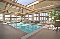 A highlight of the home is the indoor swimming pool. In warmer weather, the retractable roof and sliding glass walls open the space to the outdoors.