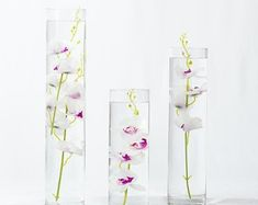 Submersible Blue/Purple/White/White with purple Orchids Floral Wedding Centerpiece with Floating Candles and Acrylic Crystals Kit by on Etsy Cylinder Vase Centerpieces, Floating Flower Centerpieces, Water Centerpieces, Floating Candles Wedding, Candle Wedding Centerpieces, Vases, Wedding Decorations, Terrarium Wedding, Purple Orchids