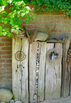 Yard art from old beams. Love the rocks stuffed in the crevice!