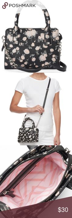 """Candie's® Micro Black Floral Crossbody Satchel NWT Complete your look when you accessorize with this classically designed Candie's crossbody satchel. Color-Black Foil Floral Brand-Candies Approx-5.63""""H x 7.38""""W x 2""""D Handles: approx-3.5"""" drop  Removable crossbody strap: 18""""-29"""" drop  Silver-tone hardware Zipper closure  Interior-Main compartment & zip pocket  Faux leather  Cotton lining  Wipe clean NWT-New with tags Candie's Bags Crossbody Bags"""