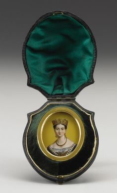 Royal Portrait Miniature of Young Queen Victoria Circa 1840 Of verre églomisé, facing the viewer wearing a gold crown and necklace above an ermine-trimmed robe, on a gold pane, within an oval gilded frame, in original leather case-1 7/8 in. long