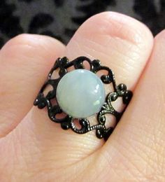 Victorian Style Adjustable Black Filigree Ring with White Serpentine Cabochon $10.00