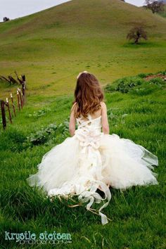 Flower girl. Lace up back is charming and easy to do.