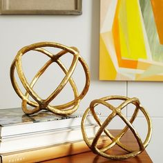 Maybe mixed with a taller vase and books as shown?   Sculptural Spheres | West Elm