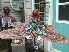 Fairy on dragonfly made using electrical wire, aluminum foil, t-shirts, lace and wool with the fabric all dipped in paverpol.