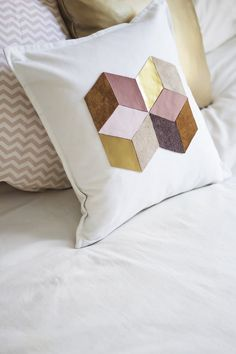 """Is your living space lacking a little design flair? No matter what your style is, a decorative pillow is the simplest way to add a certain """"je ne sais quoi"""" to your home; and if you've got a white pillowcase hanging around, then you're already halfway there. Here are a few easy DIYs to give your white pillow case a little more style. Grab some paint, tape, and cork and go for it!"""