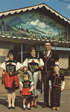 SWISS FAMILY, SWISS FESTIVAL, SWISS CHALET      SWISS FAMILYSugarcreek, Ohio  This family in authentic Swiss dress is typical of the many families that parade each Fall at the time of the famous Swiss Festival in Sugarcreek. The building in the background is just one of a great number that have a Swiss Chalet facade. The Alpine scene painted on it is of the famous Gottard Pass or R.R. tunnel through the Alps connecting Switzerland with France.