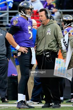 Quarterback Joe Flacco #5 of the Baltimore Ravens talks to Offensive Coordinator Gary Kubiak in the second half of a game against the Tennessee Titans at M&T Bank Stadium on November 9, 2014 in Baltimore, Maryland.