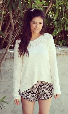 Love the shorts and sweater together !