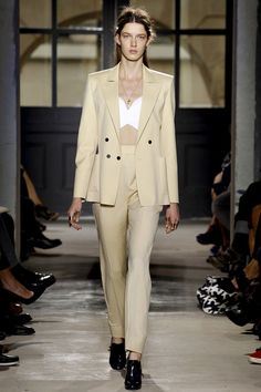 "a chic pantsuit from Balenciaga. The look here has softened from his typical ""warrior"" woman"