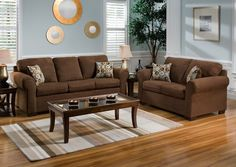 Brown Set Sofa Soft of Fabric Sponge with Glass Table using Legs made of Fine Wood and Blue Wall Color Decorating of Painting also Brown Wooden FLoor Ikea Living Room Design