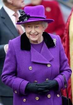 Royal Purple. Queen Elizabeth II and Prince Phillip, Duke of Edinburgh visit Southwark Cathedral on November 21, 2013 in London, England.