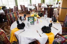 Disney ride attraction poster wedding centerpieces plus mouse ears for each guest at a Citricos Disney wedding