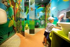 The main purpose in designing the children's toilet in Tel Aviv was to create a special and different atmosphere. The space was designed as a colorful and wild jungle, where design controls every detail. The space clearly belongs to children, but. Childrens Bathroom, Baby Bathroom, Toddler Play Area, Kids Toilet, Kids Cafe, Public Bathrooms, Toilet Design, Make Pictures, Cool Cafe