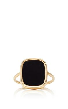 Set in an antique-inspired construction, this ring by **Ginette NY** features a large smooth cabochon.