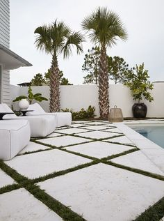 Exterior application of large format Peacock Pavers in RICE WHITE
