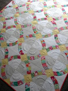 Purrfect Stitchers - great way to quilt the paper-pieced wedding ring quilt