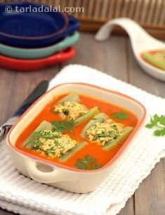 Forget the bland taste of lauki now. . . Stuff it with a low fat paneer mixture and cook in a spicy tomato gravy for a pleasant surprise!