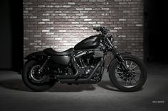 Harley Iron 883.... all blacked out... this WILL be mine one day!