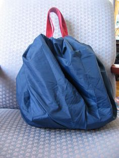 Drawstring waterproof bag cover made out of an umbrella.  What  could be more lightweight and waterproof!?