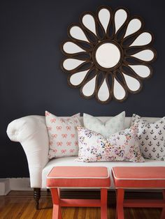 Add a peach accent to a neutral living room. (http://blog.hgtv.com/design/2013/07/01/hgtvs-color-of-the-month-is-our-juciest-hue-yet/?soc=Pinterest)