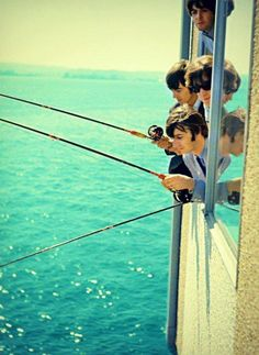 Beatles fishing from their Edgewater hotel room in Seattle.