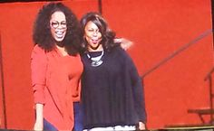 """September 2014 - Mega Star, Philanthropist, Teacher, Talk Show Host, Producer and Owner of The Oprah Winfrey Network (OWN). Oprah Standing On Stage During """"The Life You Want Weekend Tour In Michigan With Attendee Cheryl Ketchens From Jackson, MI"""