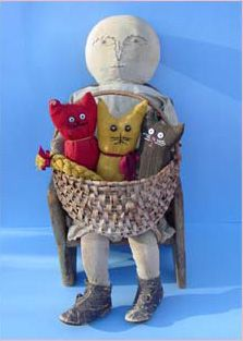 Nothings better than a rag doll holding a basket of sock cats.
