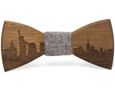 Our handmade Wooden skyline bow ties are the perfect addition to your bowtie collection. Pick your favorite skyline to create a personal yet unique piece of neckwear that will be a go-to statement maker for years to come. The warm Walnut wood leaves a dark engraving to bring out the best in your skyline while the gray denim centerpiece brings a classic feel that will compliment any outfit. Look no further for the perfect personal yet fashion forward gift to give any man for any occasion…